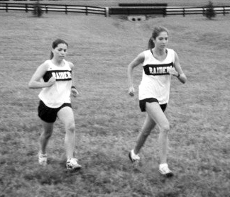 Holly and I running in a high school cross country race.  I'm on the right.